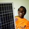 Handling solar panels in Rwanda. ©Julien Simery